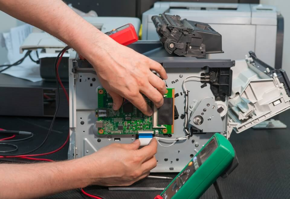 man fixing harddrive